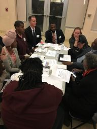 Student Representative Tatiana Robinson leads a table discussion on retention with Deputy Mayor of Education Paul Kihn and other education leaders.