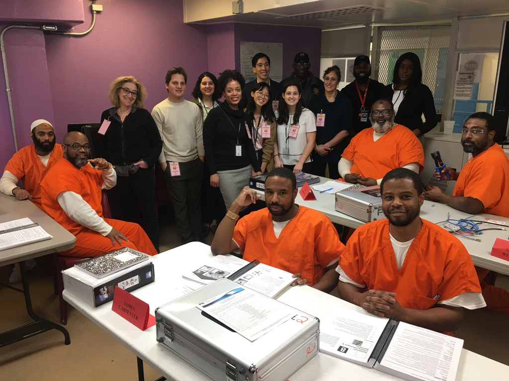 A group photo of State Board staff and the CTECH class at D.C. Jail.